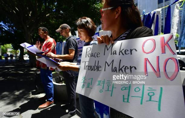 Activists gather in front of the Consulate General of the Republic of Korea building in Los Angeles California on June 8 2018 where KoreanAmericans...