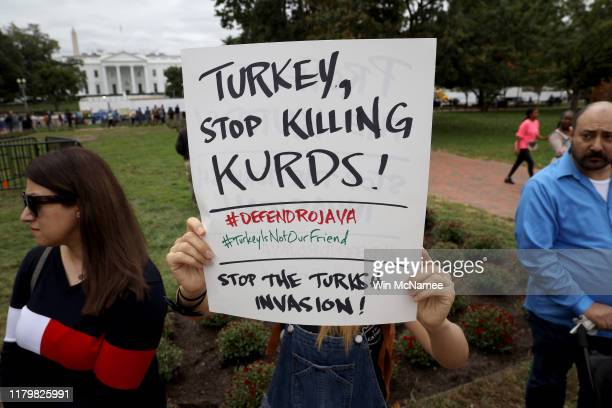 Activists gather in front of the White House to protest U.S. President Donald Trump's decision to withdraw U.S. Forces from northeast Syria October...