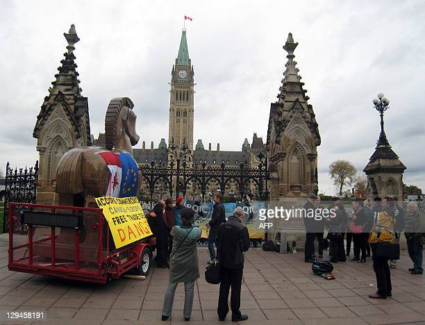 Activists gather on October 17 2011 in front of the Canadian parliament in Ottawa Ontario after Canadian and European civil society groups delivered...