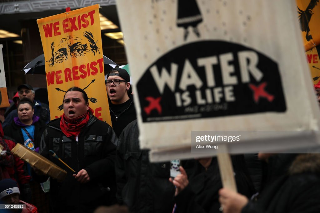 Activists gather outside the Army Corps of Engineers Office to protest against the Dakota Access Pipeline March 10, 2017 in Washington, DC. The Standing Rock Sioux Tribe held the event with a march to the White House to urge for halting the construction of the project.