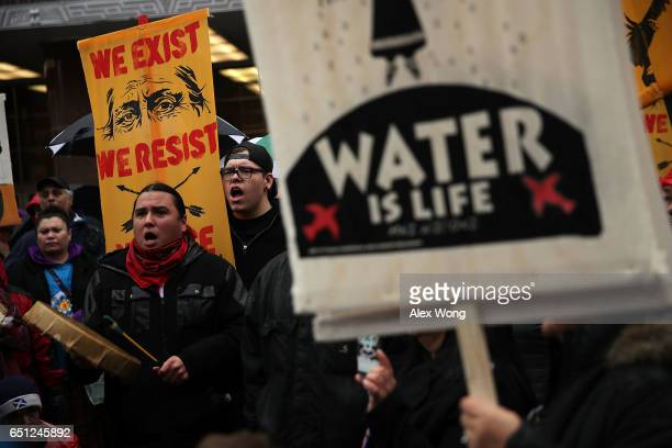 Activists gather outside the Army Corps of Engineers Office to protest against the Dakota Access Pipeline March 10, 2017 in Washington, DC. The...