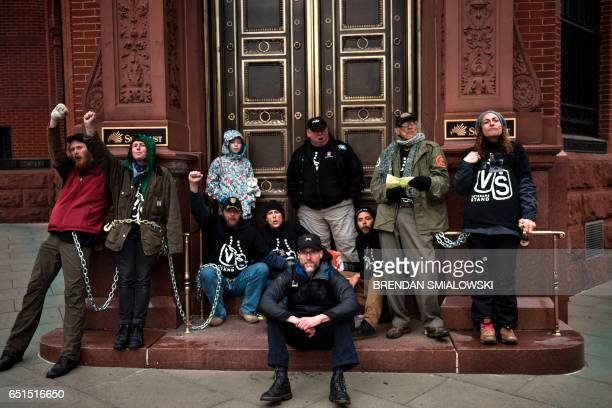 Activists gather protesting the Dakota Pipeline chain themselves to a Sun Trust Bank during the Native Nations Rise protest March 10 2017 in...