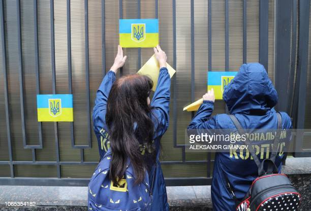 Activists glue Ukrainian flag on the fence of Russian consulate in the Black Sea Ukrainian city of Odessa on November 26 2018 after Russian navy...