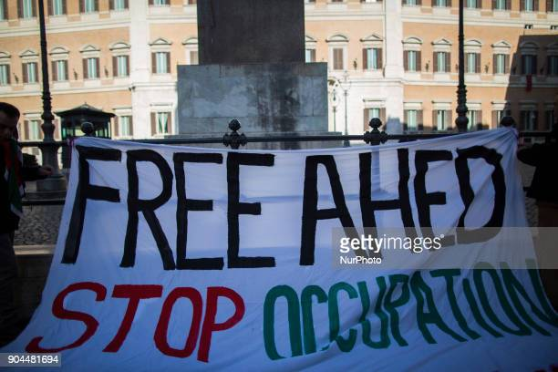 Activists hang a banner with a sign to ask the liberation of Ahed Tamimi in front of italian Parliament on January 13 2018 A hundred of activists...