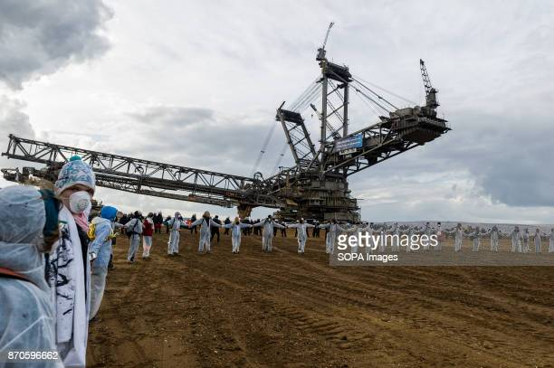 Activists have formed a circle in front of the excavator in the pit Approximately 2500 activists invaded the pit of the lignite open cast mine...