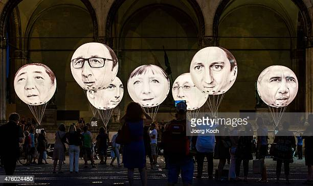 Activists have installed balloons decorated with the portraits of Japanese Prime Minister Shinzo Abe French President Francois Hollande Italian Prime...