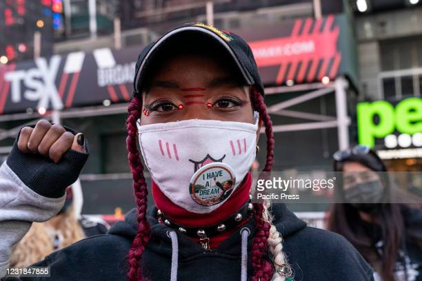 Activists held protest in memory of Breonna Taylor in Times Square on the anniversary of her murder by Louisville, Kentucky police. Some protesters...