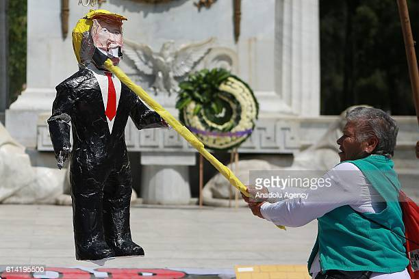 Activists hit the 'Pinata' of Donald Trump during demonstration against the US Republicans' Presidential candidate Donald Trump's policies against...