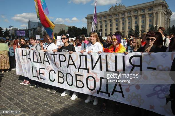 Activists hold a banner that reads 'Our Tradition is Freedom' during the Kharkiv Pride 2019 event held in Svobody Square in support of the LGBT...