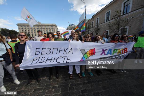 Activists hold a banner that reads 'Security and Equality' during the Kharkiv Pride 2019 event held in Svobody Square in support of the LGBT...