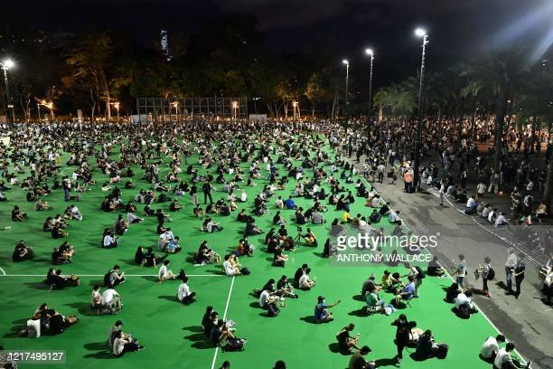 Activists hold a candlelit remembrance in Victoria Park in Hong Kong on June 4 after an annual vigil that traditionally takes place in the park to...