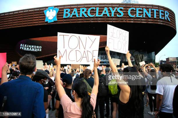 Activists hold a rally in response to the police killing George Floyd in front of Barclays Center on May 29 2020 in the Brooklyn borough of New York...