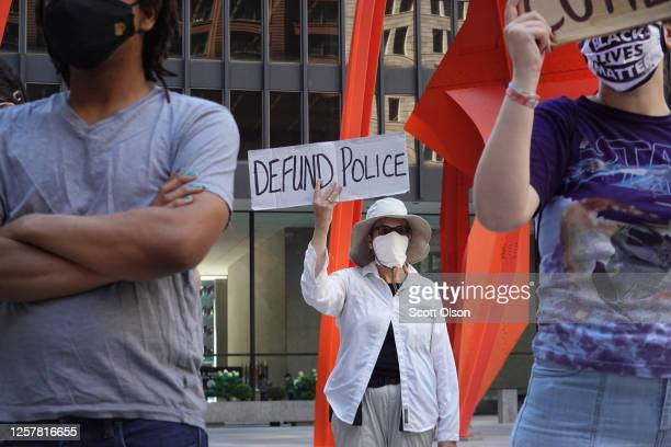 Activists hold a rally in the federal building plaza to protest the Trump administration's pledge to send federal agents into Chicago to deal with...