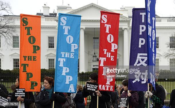 Activists hold a rally to protest the TransPacific Partnership in front of the White house on February 3 2016 in Washington DC The TPP trade pact is...