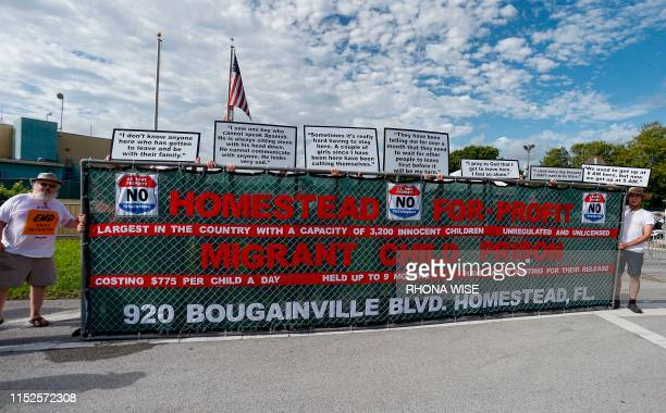 Activists hold a sign in front of a detention center in Homestead Florida where migrant children who have been separated from their families are...