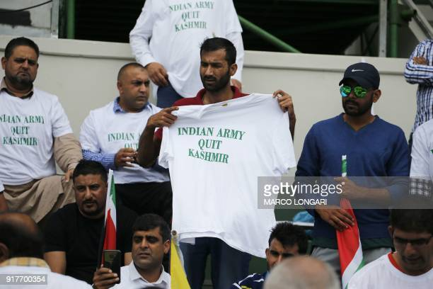Activists hold and wear tshirts with messages reading 'Indian army quit Kashmir' at the beginning of the fifth OneDay International cricket match...