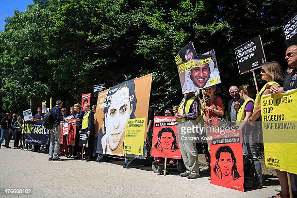 Activists hold banners as they demonstrate outside the Saudi Arabian Embassy against the recent Saudi court ruling that upheld a previous verdict of...