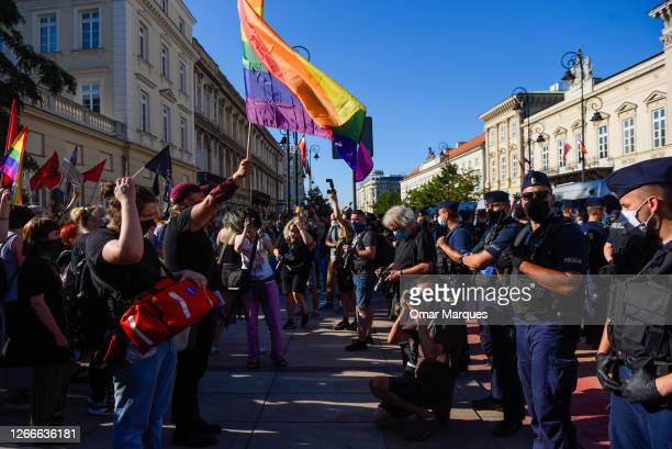 Activists hold banners during a counter protest against an anti-LGBT far right rally on August 16, 2020 in Warsaw, Poland. At the same time, a...
