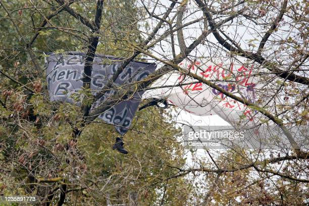 Activists hold banners in the trees of. The location of the left alternative site trailer Camp Kopi on October 15, 2021 in Berlin, Germany. The...
