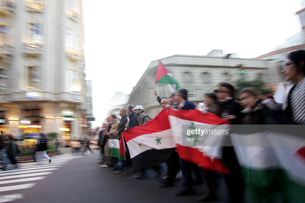 Activists hold Palestinian flags during a demonstration in support of Palestine, on June 4, 2010 at Buenos Aires. Earlier this week the Freedom Flotilla, a fleet of ships with international humanitarian aid for the Palestinians in the Gaza Strip, was raided by the Israeli army. Nine activists were killed and several more were injured. AFP PHOTO/ Maxi Failla