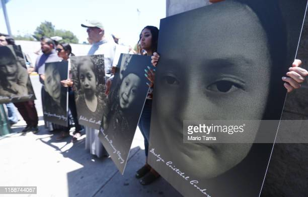Activists hold photos of migrant children who died trying to cross the USMexico border on June 27 in Ciudad Juarez Mexico El Paso Bishop Mark Seitz...