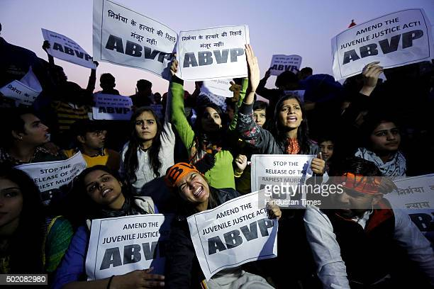 ABVP activists hold placard and shout slogans demanding the death penalty for the man convicted over the Nirbhaya December 16 gangrape during a...