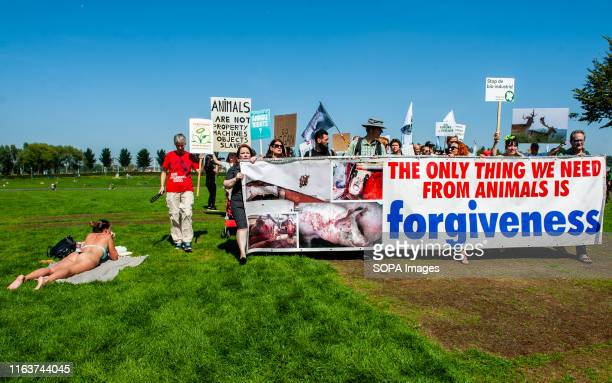 Activists hold placards and a banner saying the only thing we need from animals id forgiveness during the demonstration This is the second time that...