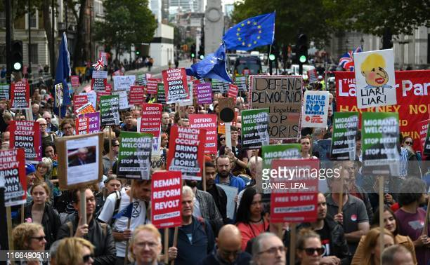 Activists hold placards and wave EU flags during an antigovernment protest calling for the Prime Minister's resignation outside Downing Street in...