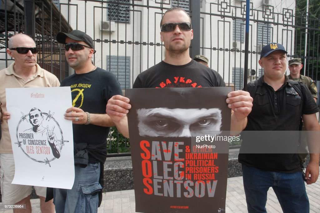 Activists hold placards as they take part in a protest for the release of Ukrainian director Oleg Sentsov and other political prisoners, near Russian Embasy in Kiev, Ukraine, 13 June 2018.