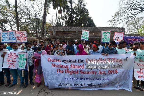 Activists hold placards during a demonstration demanding the repeal of the Digital Security Act, in Dhaka on February 27, 2021 following the death of...