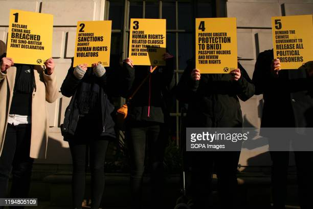 Activists hold placards during the protest Activists rally in solidarity with the prodemocracy movement in Hong Kong and in protest at China's...