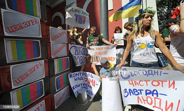 Activists hold placards which reads �Freedom of speech� �I like watch TV� �Control over media � control over citizens� during a protest against...