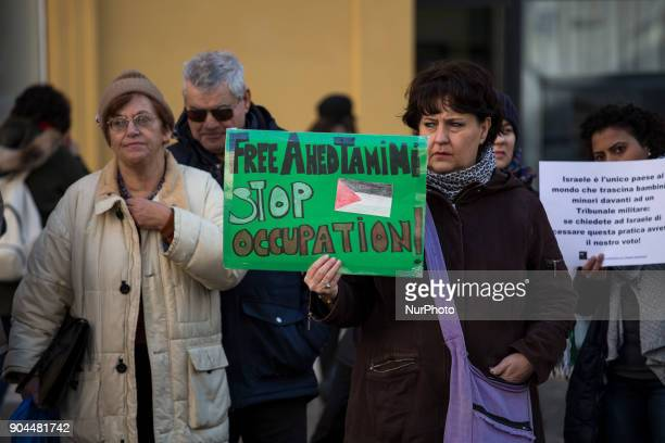 Activists hold placards with a sign to ask the liberation of Ahed Tamimi in front of italian Parliament on January 13 2018 A hundred of activists...
