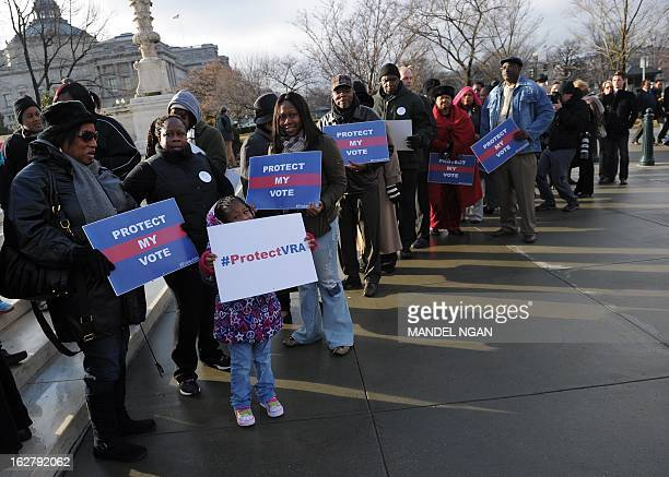 Activists hold provoting rights placards outside of the US Supreme Court on February 27 2013 on Capitol Hill in Washington DC as the Court prepares...