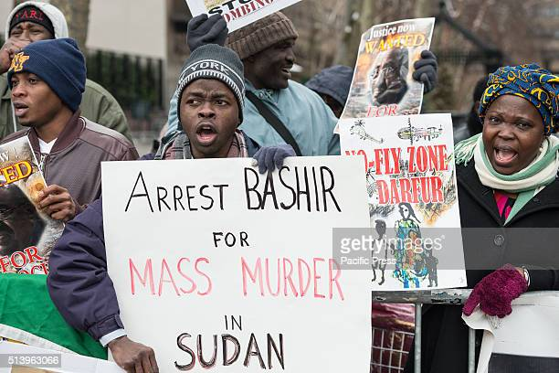 Activists hold signs and chant demanding the arrest of Omar alBashir On the seventh anniversary of the first issuance by the International Criminal...