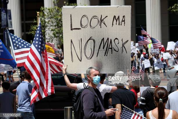 Activists hold signs and protest the California lockdown due to the coronavirus pandemic on May 01, 2020 in San Diego, California. The protesters...