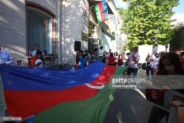 KHARKIV UKRAINE JULY 21 2020 Activists hold the large flag of Azerbaijan outside the Honorary Consulate of the Republic of Azerbaijan during a...