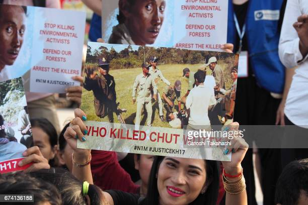 Activists hold up posters of slain prominent environmental activist Chut Wutty during a commemoration rally for the fifth anniversary of his death...
