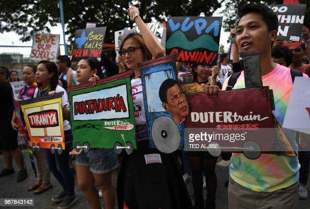Activists holding antiPresident Rodrigo Duterte's placards join thousands of members of Lesbian Gay Bisexual Transgender/Transexual Queer hold a...