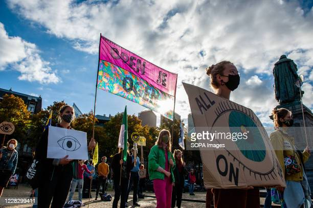 Activists holding climate placards during the demonstration. The climate activist group, Extinction Rebellion in The Netherlands has planned a new...