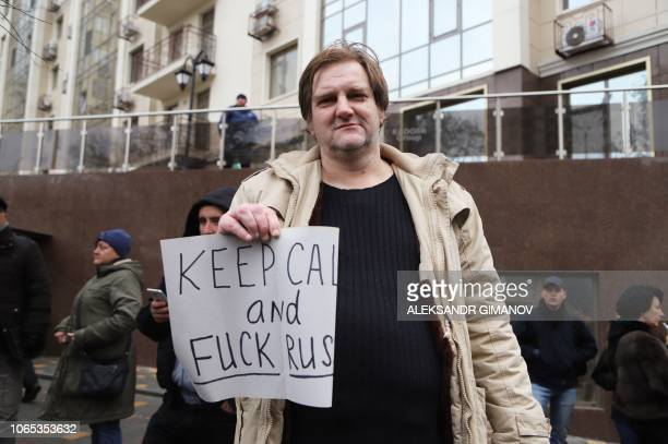 Activists holds a placard during protest rully at Russian consulate in Black Sea Ukrainian city of Odessa on November 26 2018 Ukraine's military was...
