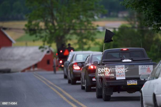 Activists in cars decorated with protest posters against the Klu Klux Klan caravan through the Quarryville area where the KKK intend to hold a rally...