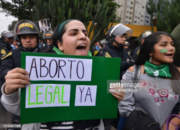 Activists in favour of the approval of a bill to legalize abortion in Argentina demonstrate outside the Argentine Embassy in Lima on August 8 2018...
