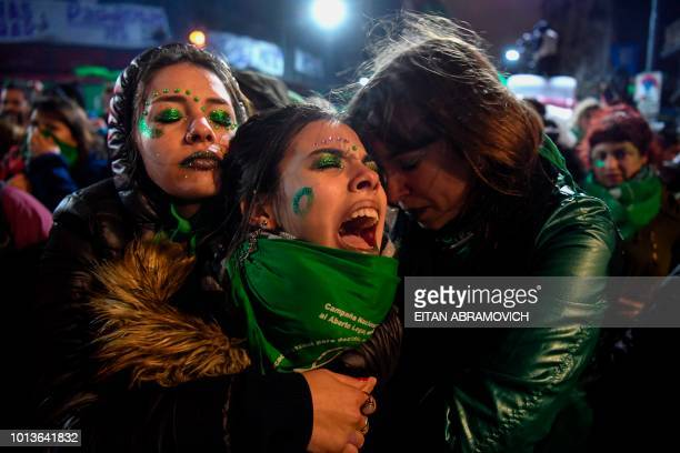 TOPSHOT Activists in favour of the legalization of abortion comfort each other outside the National Congress in Buenos Aires on August 9 2018 after...