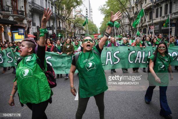 Activists in favour of the legalization of abortion march for the first time since the rejection of the abortion bill by the Argentine Senate during...