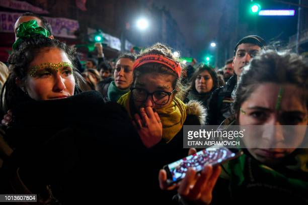 Activists in favour of the legalization of abortion react outside the National Congress in Buenos Aires on August 9 after senators rejected the bill...