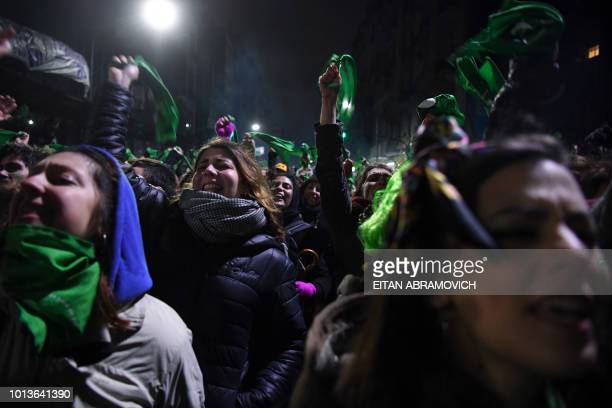 Activists in favour of the legalization react outside the National Congress in Buenos Aires on August 9 201 8while senators vote the abortion bill...