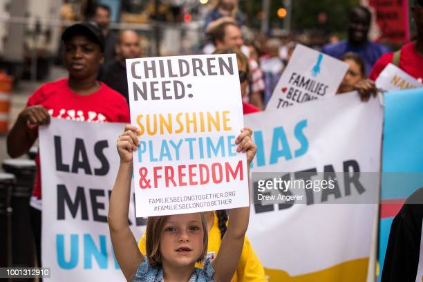 Activists including childcare providers parents and their children protest against the Trump administrations recent family detention and separation...