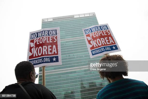 Activists including several KoreanAmericans rally against possible US military action and sanctions against North Korea across the street from the...