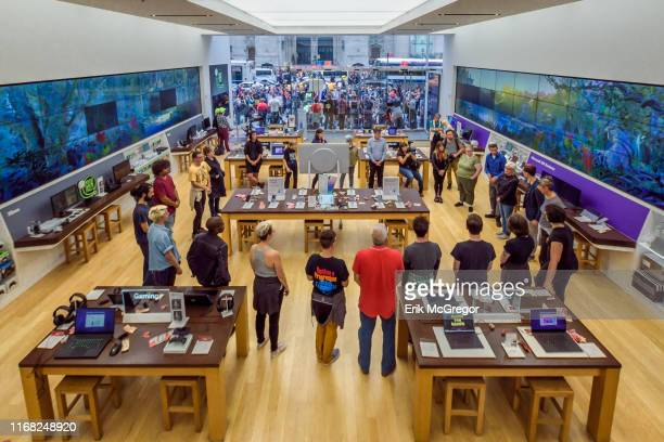 Activists inside the Microsoft store during a protest against ICE A total of 76 protesters were arrested after shutting down the Microsoft retail...